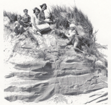 Historical Photo of a family posing on a sand dune.